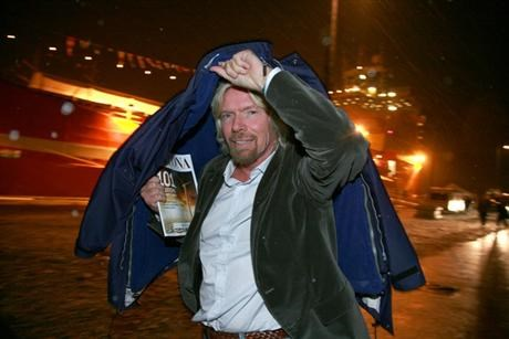 Branson with jacket over his head