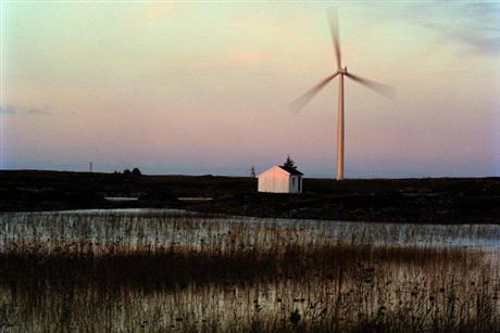 House and wind turbine with a evening sky