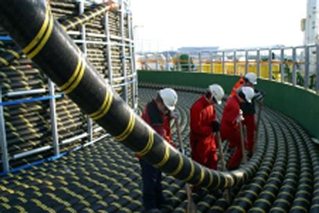 Men inspecting a cable
